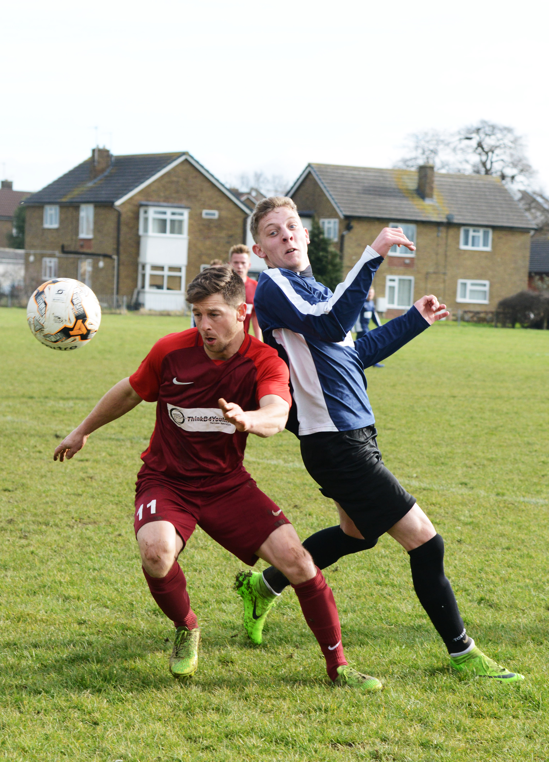 Walcot's Dean Hughes and Freshbrook's Jonathan Peachey-Score during their Knockout Cup tie                               Picture: Thomas Kelsey