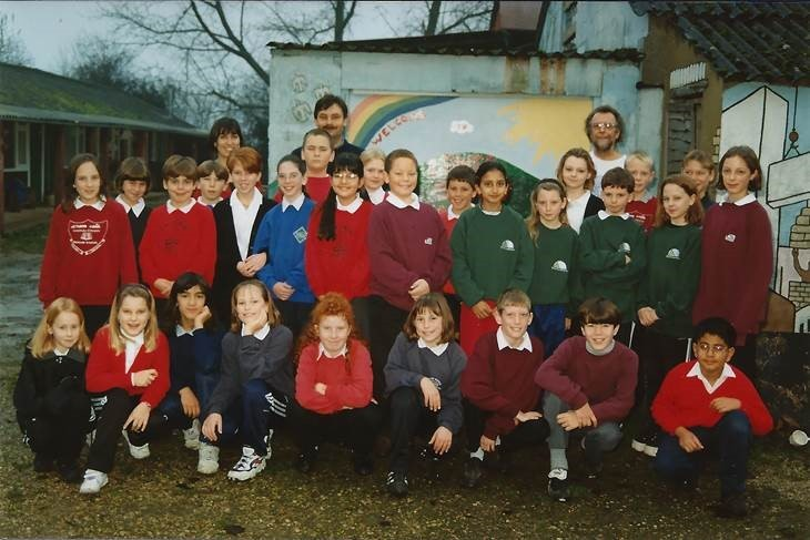 Primary school pupils with Greendown teacher Cristina Bennett, Toothill primary school headteacher Richard Jackson and community poet Marcus Moore back in 1997