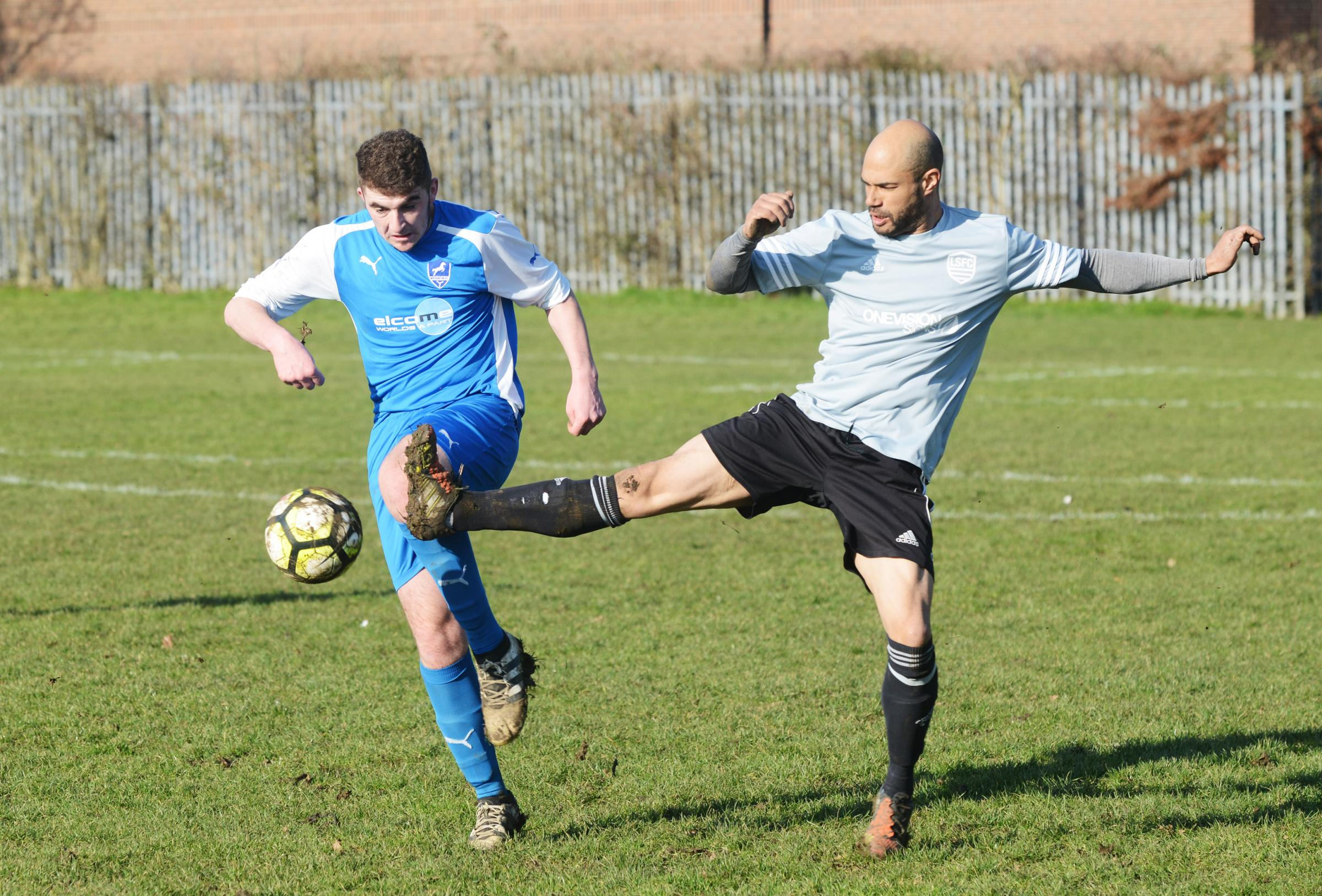 Lower Stratton player Aaron Wilson (grey) looks to challenge Wroughton Reserves' Jack Hill during Saturday's clash             Picture: THOMAS KELSEY