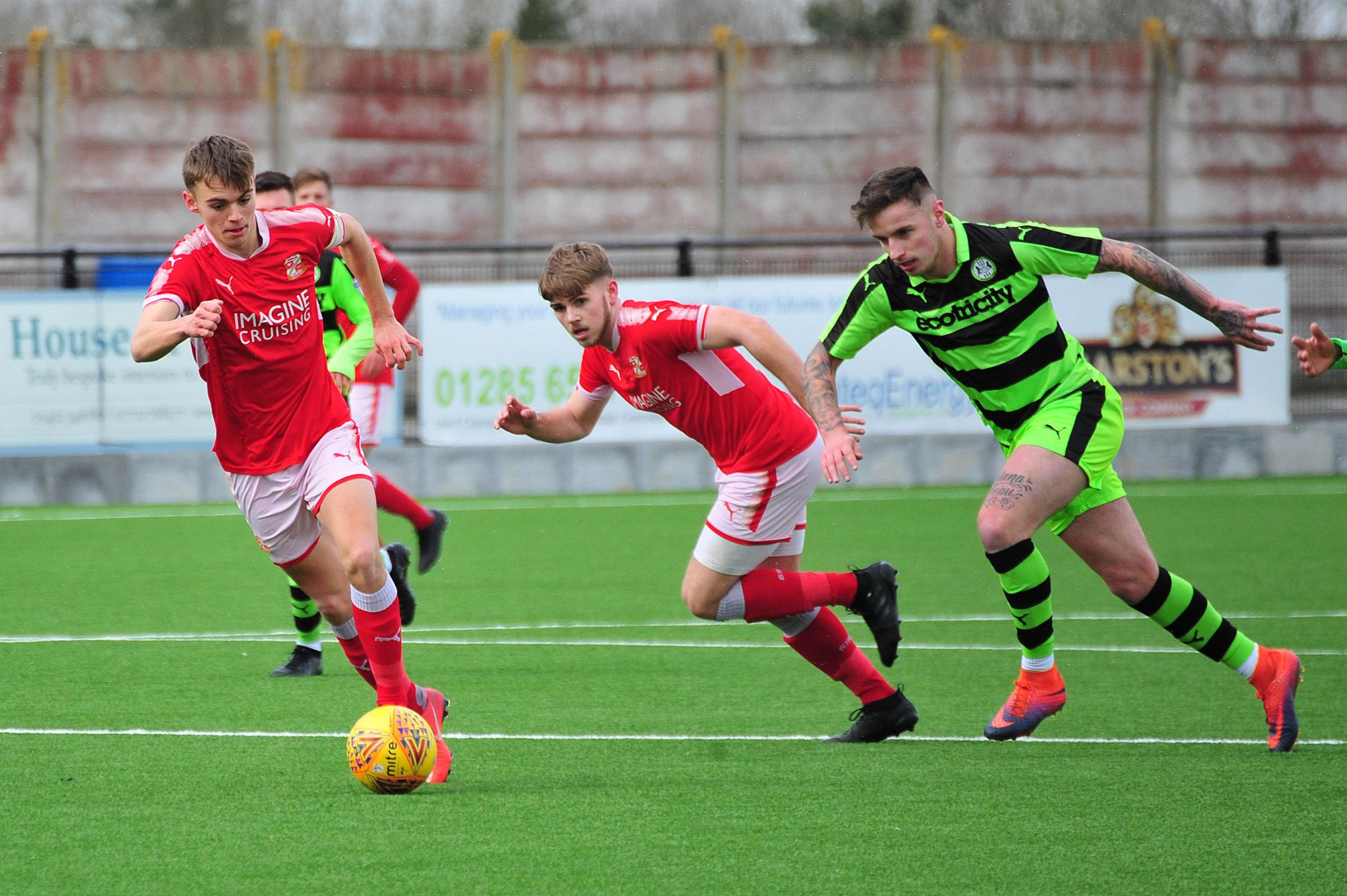 Scott Twine advances with the ball for Swindon Town. Swindon Town v Forest Green Rovers. Central League. Tuesday, February 27, 2018