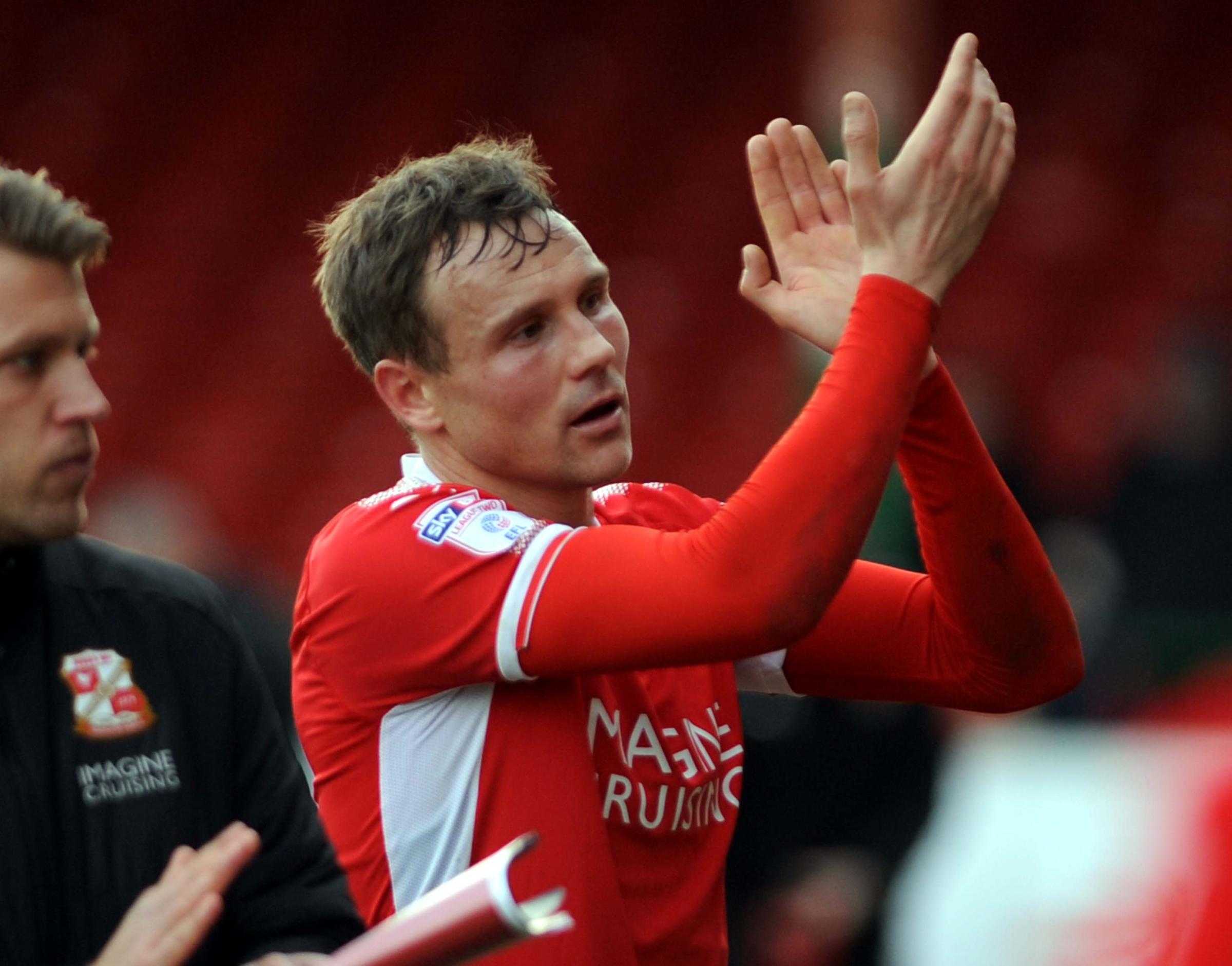 Matt Taylor applauds the County Ground faithful after the Cheltenham defeat (Picture: DAVE EVANS)