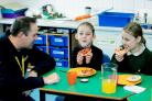 Nyland School pupils enjoy their Magic Breakfast Club with the Amazon team, who support it.