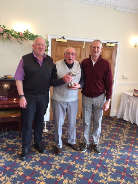Ken Titcombe presents John Burn with the Jason Titcombe Memorial Trophy.