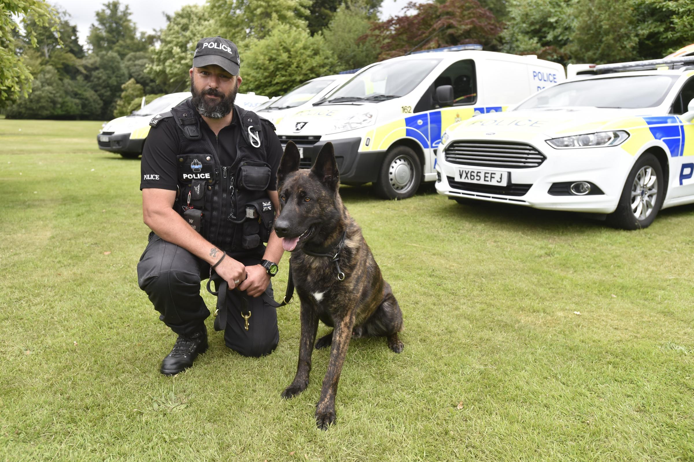 PC Simon Goodwin with police dog Fozzy. Picture: DIANE VOSE