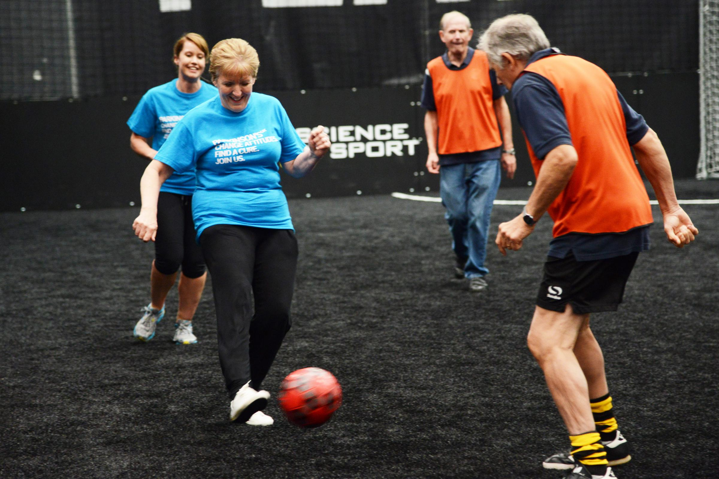 Lesley Keen takes on the opposition at Parkinson's UK's football clash. Picture: THOMAS KELSEY