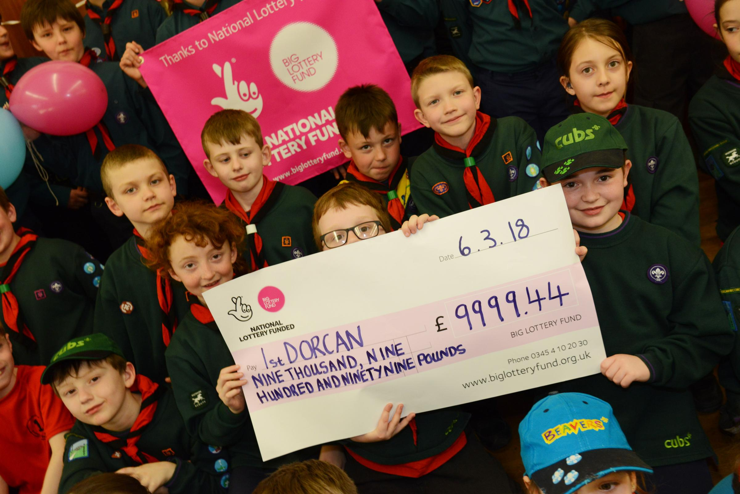 Scouts £10k grant win . Pictured scouts with their cheque..19/04/18 Thomas Kelsey.