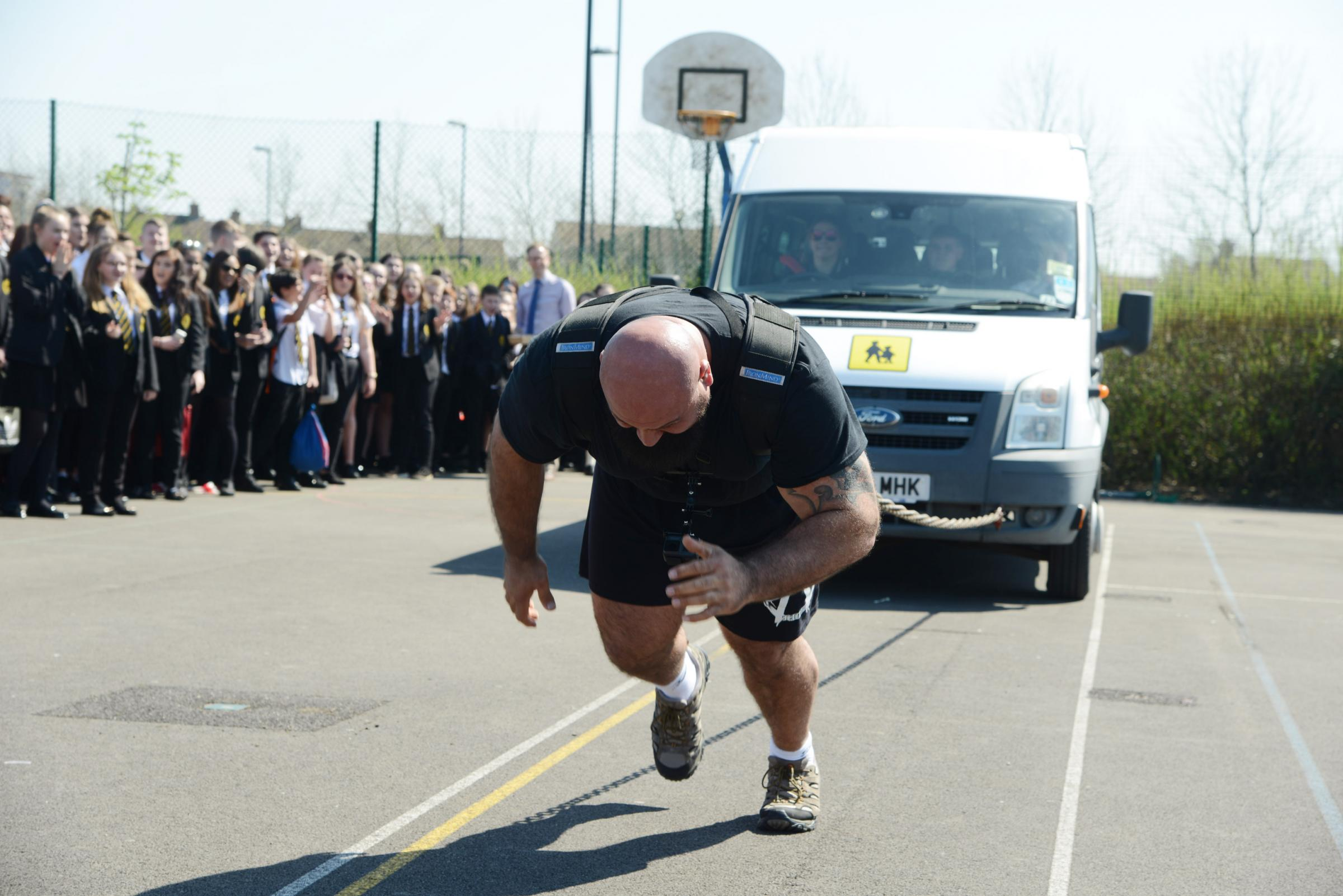 Laurence Shahlaei(4th world�s strongest man) is demonstrating his strength at Abbey Park School by pulling a bus. Pictured Laurence Shahlaei pulling the bus..19/04/18 Thomas Kelsey..