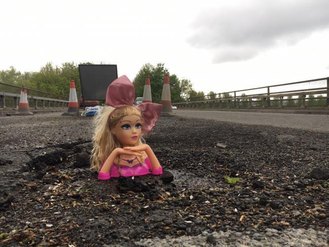 Neville Daytona fills potholes with doll's heads