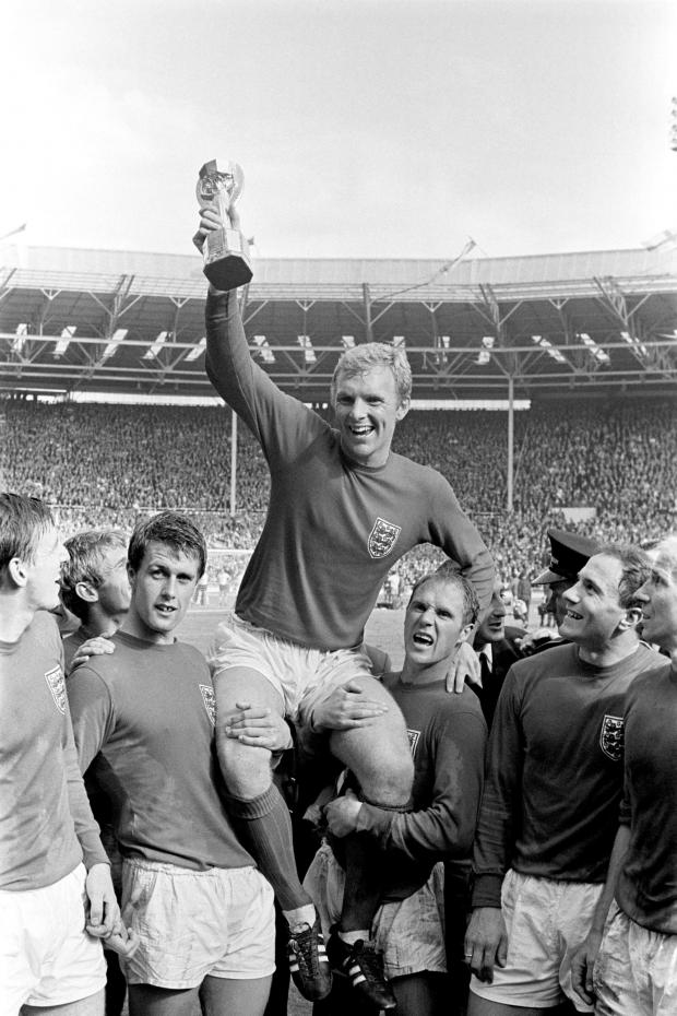 Swindon Advertiser: FINEST HOUR: England's triumphant 1966 World Cup final captain Bobby Moore chaired by hat-trick hero Geoff Hurst and Ray Wilson.