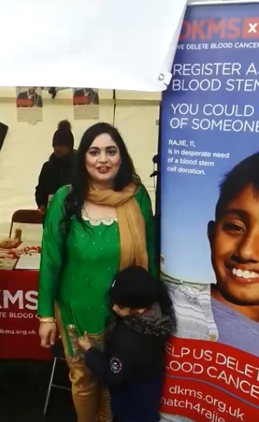 Sharon Bharaj at a DKMS stand talking about giving blood.