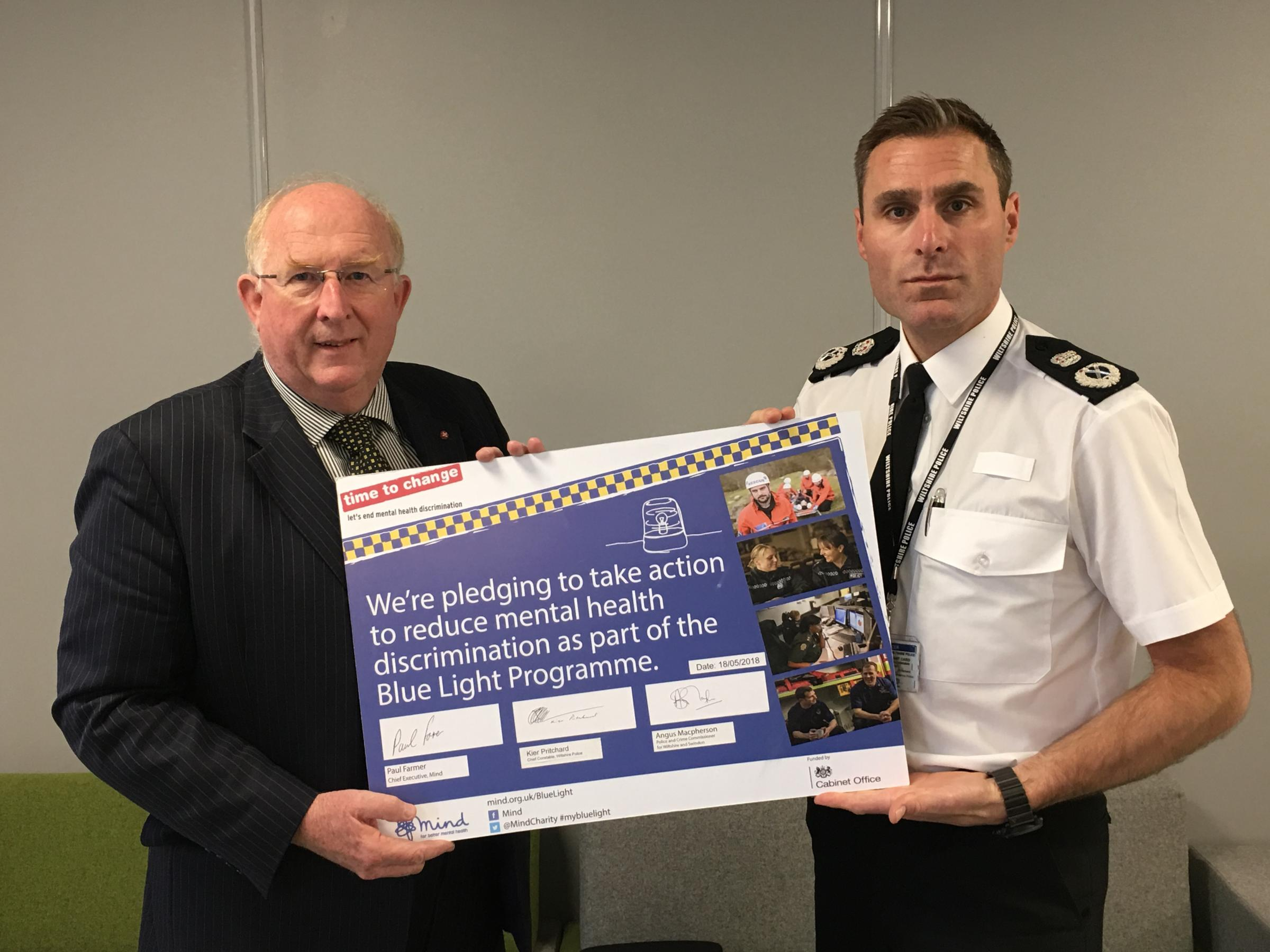 PCC Angus Macpherson and Chief Constable Keir Pritchard re-sign the Blue Light pledge.