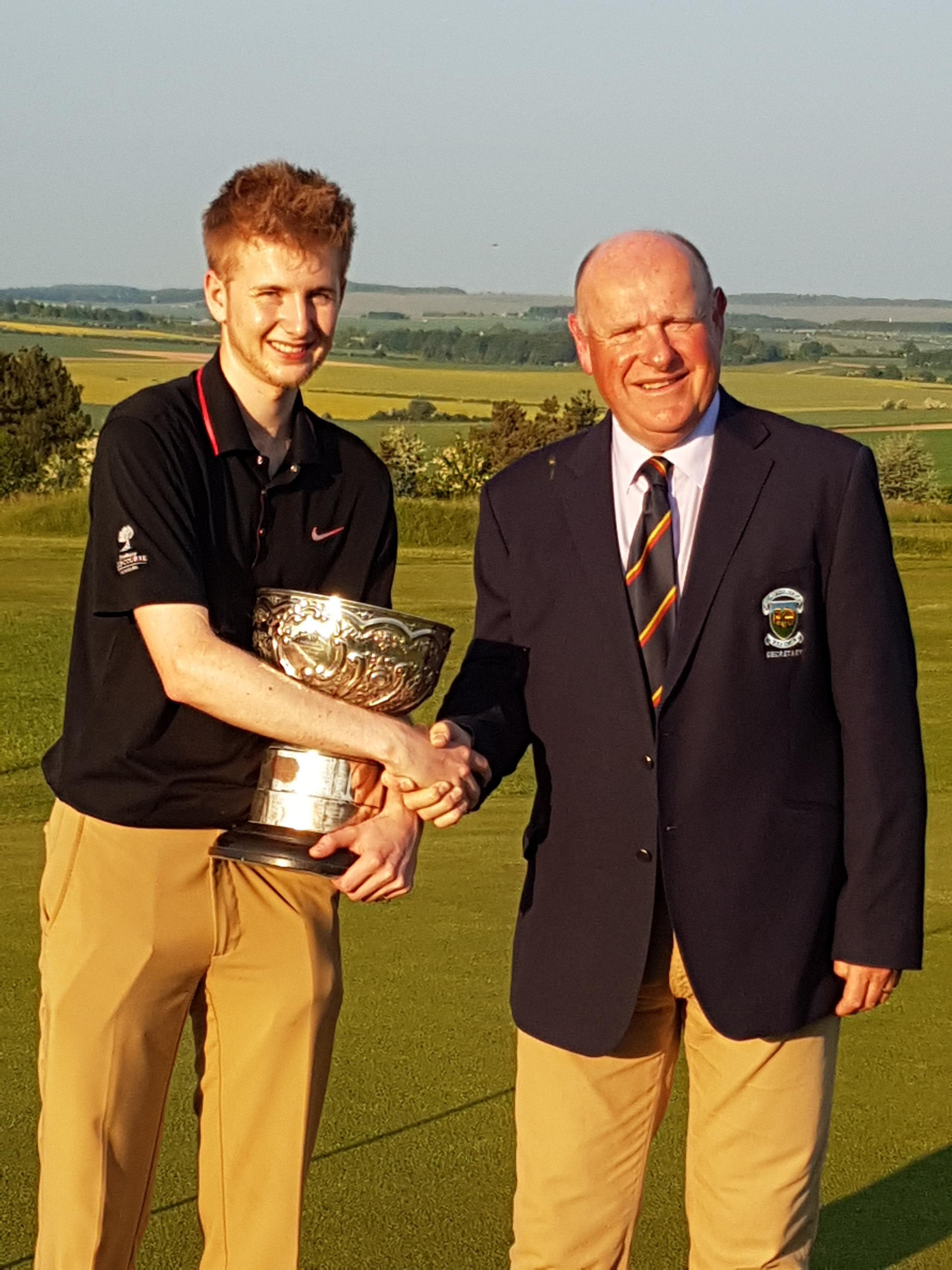 2018 Wiltshire county champion Tom Law (Broome Manor) with the trophy and county secretary Scott Talbert