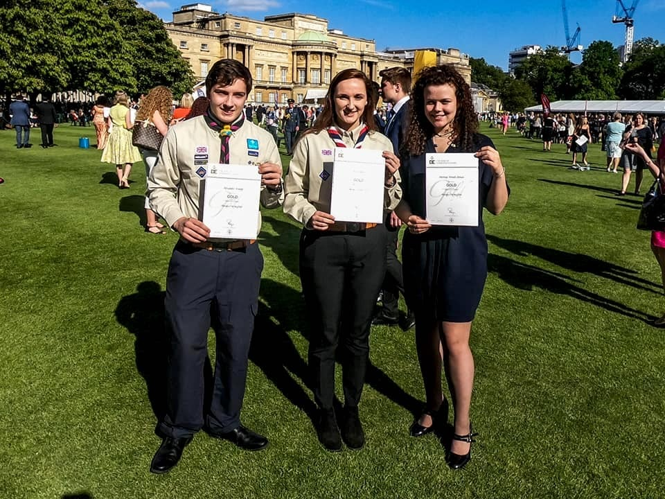 Alice Moore, Patricia Woods-Annan and Alex Knapp receiving their Gold Award certificates from sailer David Carr.