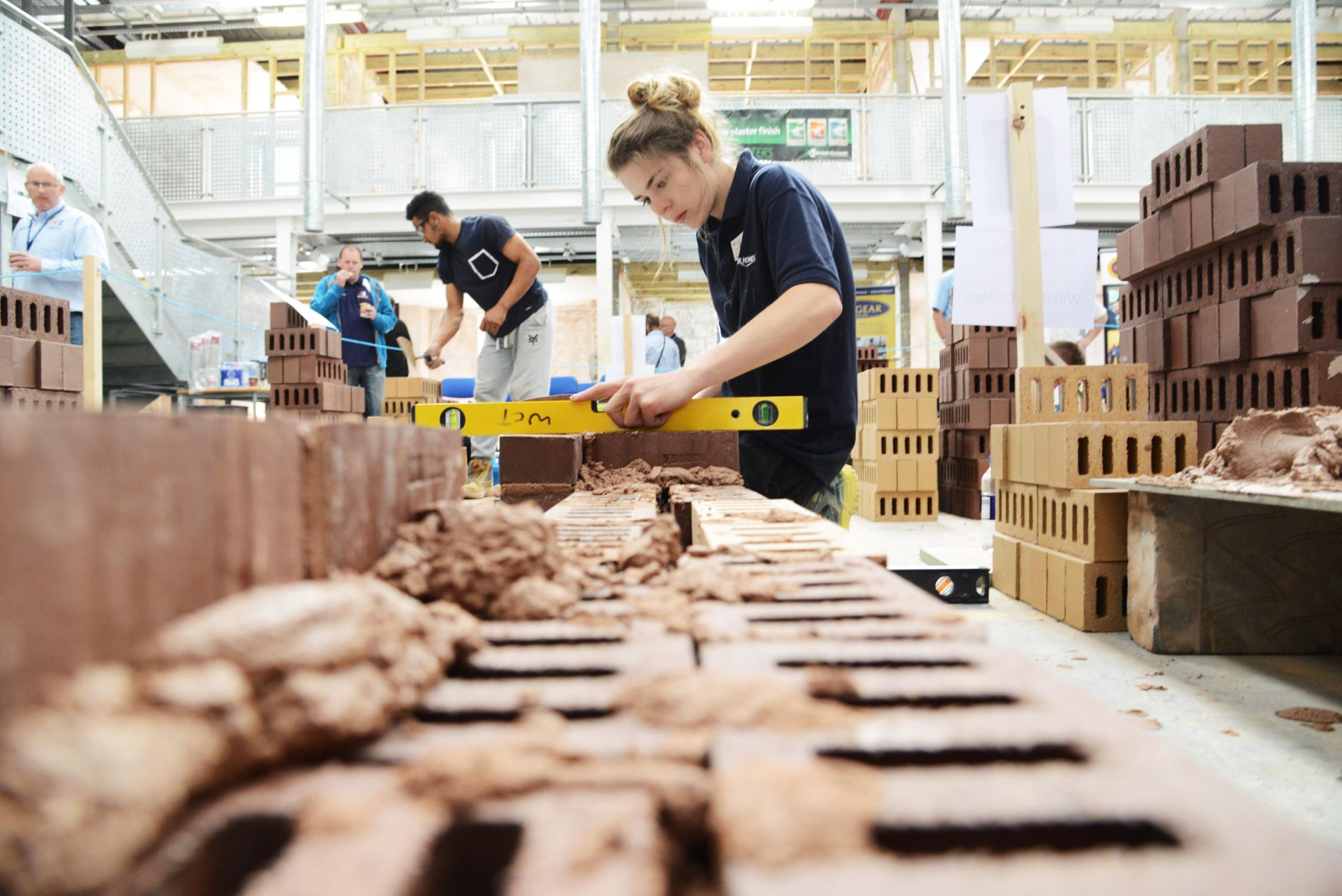 Shaynee Davis gets busy at the bricklaying competition. Pictures: THOMAS KELSEY