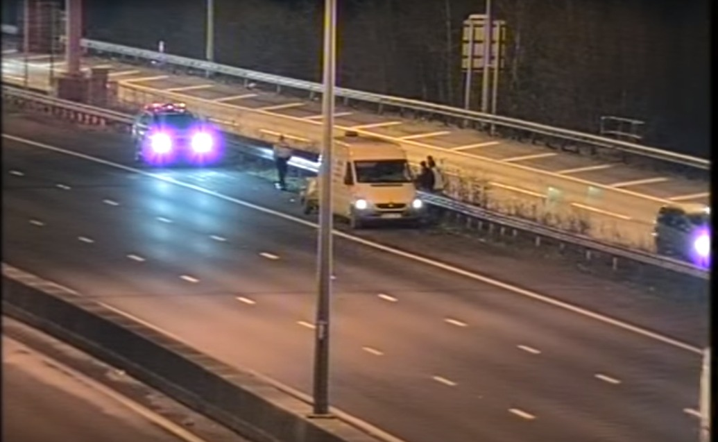 A driver stops on the hard shoulder of a motorway.