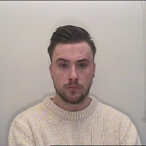 Aaron Kennett who stole more than £200,000 from his employers to pay drug debts and travel the world