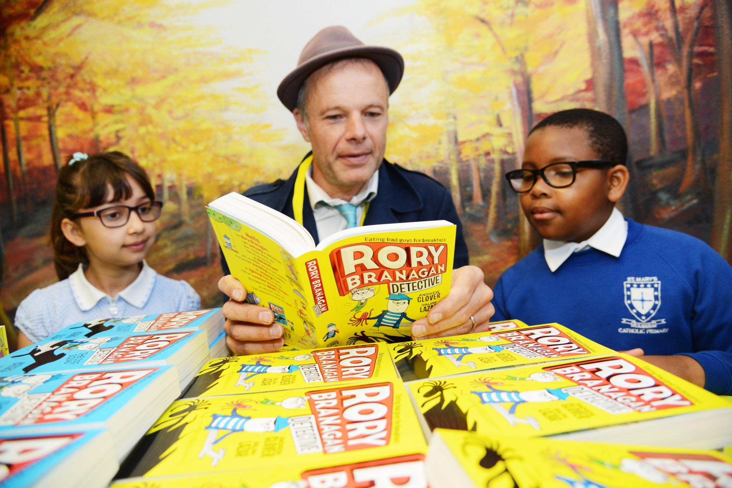 Andrew Clover gave readings of his work to pupils at St Mary's. Picture: Thomas Kelsey