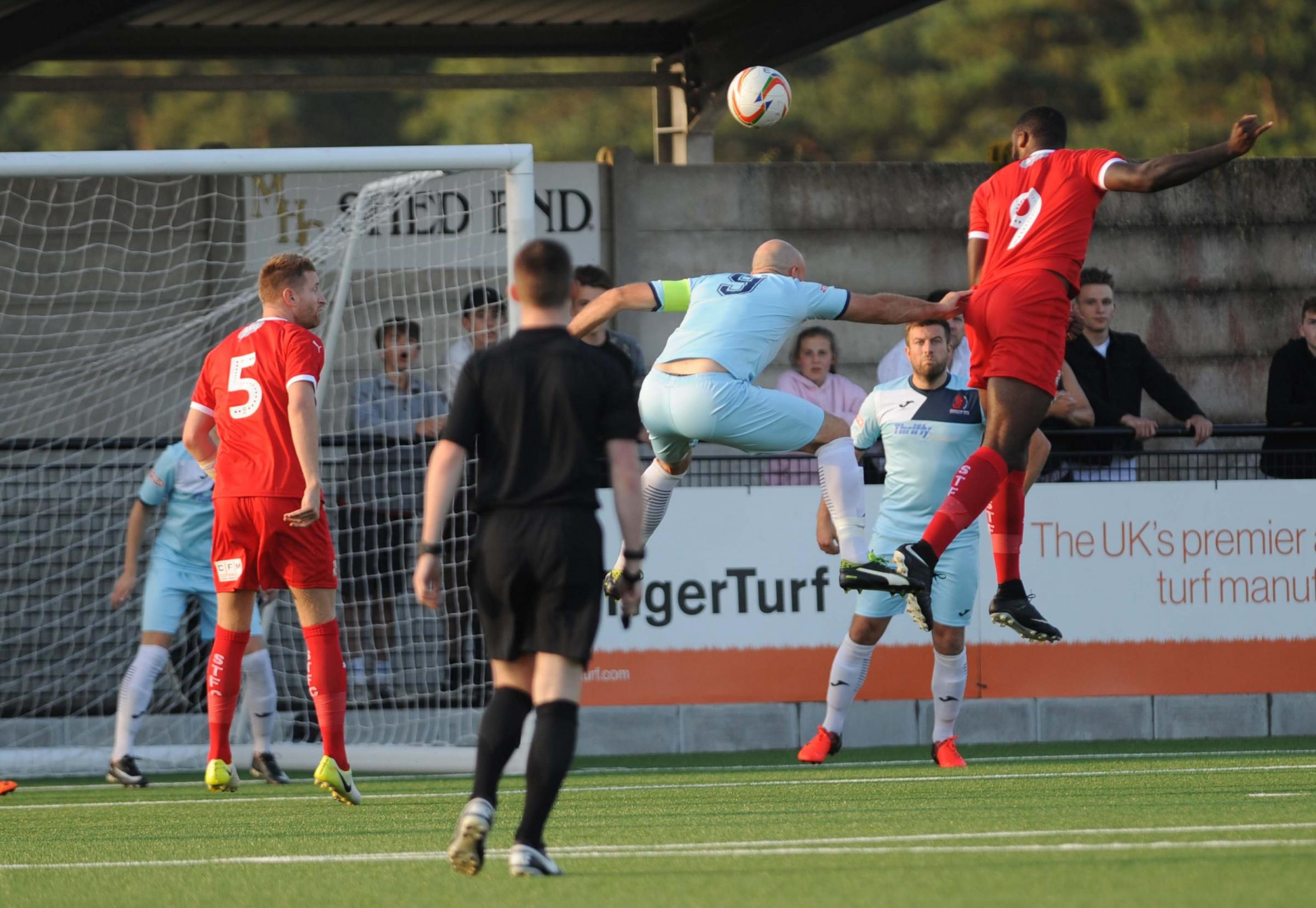 Town trialist Shamir Mullings heads goalwards against Cirencester