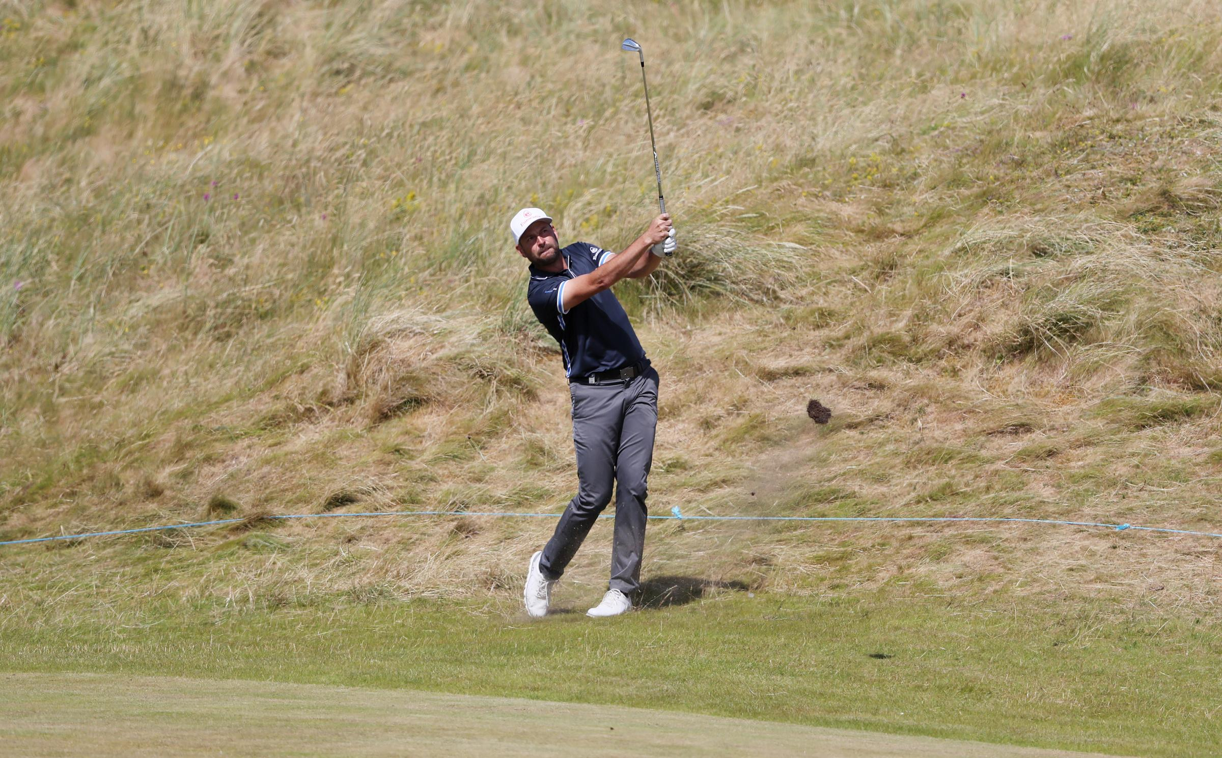 England's David Howell plays from the rough on the sixth during day one of the Dubai Duty Free Irish Open at Ballyliffin Golf Club..