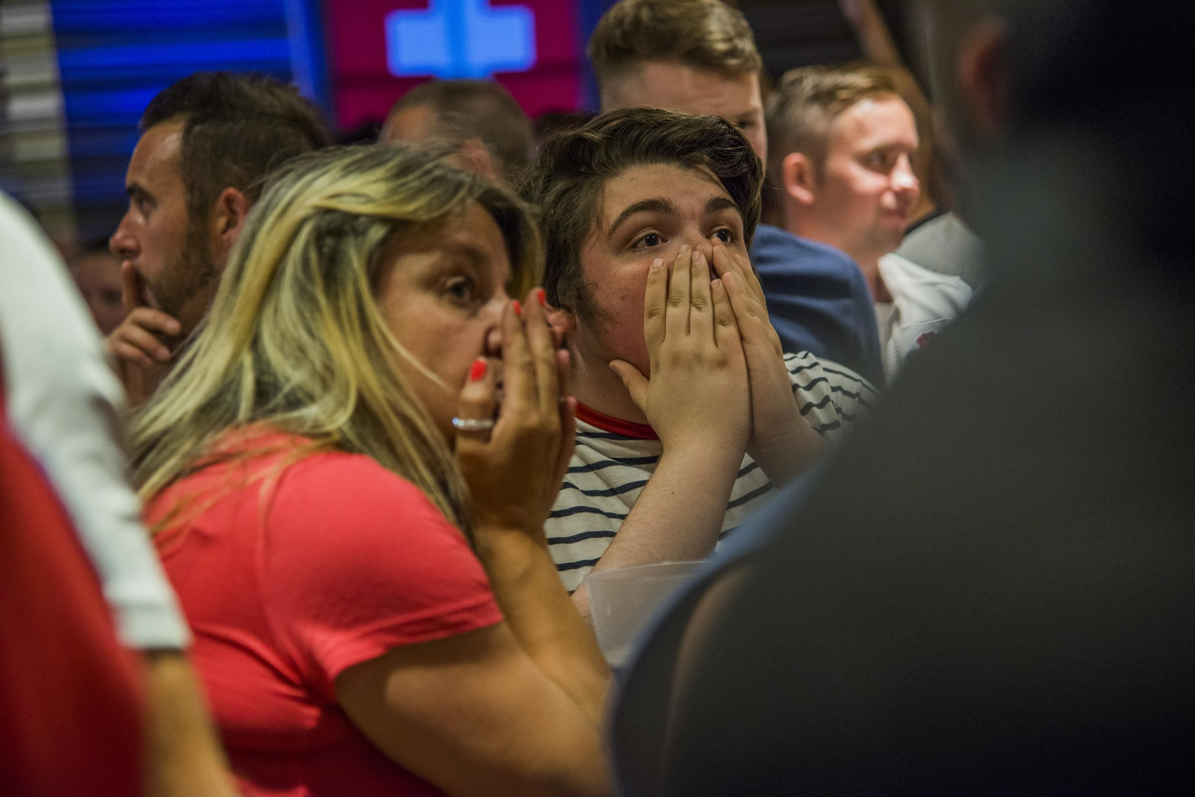 Despondent football fans at The Merlin. Picture: THOMAS KELSEY