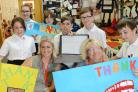 £20,440 donation from PTA to buy new bus and laptops for the school.  Pictured Lucy Harris and Joanne Fusco with students..03/07/18 Thomas Kelsey.