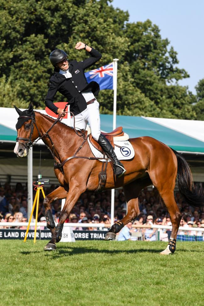 Tim Price (NZL) riding Ringwood Shy Boy celebrates after completing the showjumping phase at the Land Rover Burghley Horse Trials. Picture: