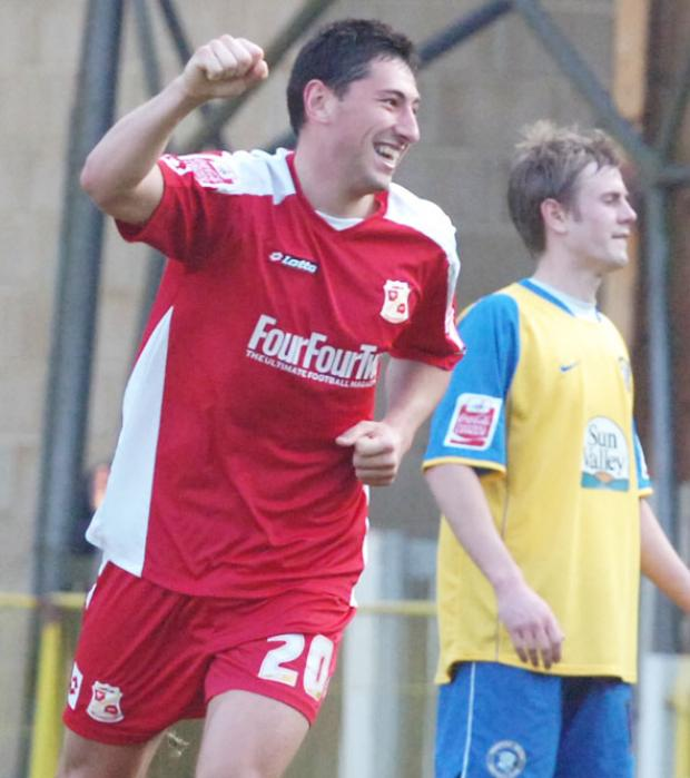 Billy Paynter scores Swindon's third goal in their win over Hereford..