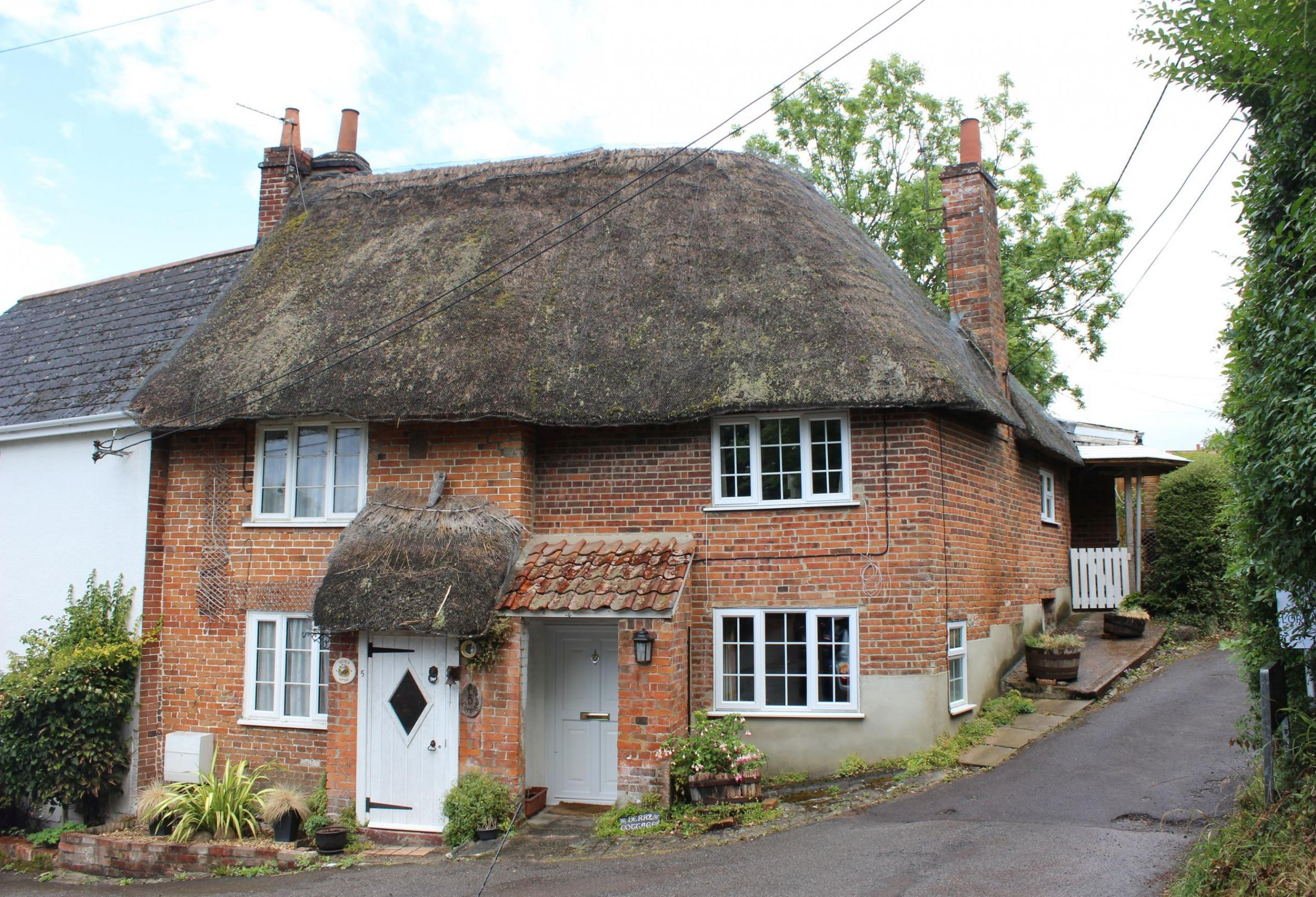 This three bedroom thatched cottage in Bratton has just been reduced in guide price.