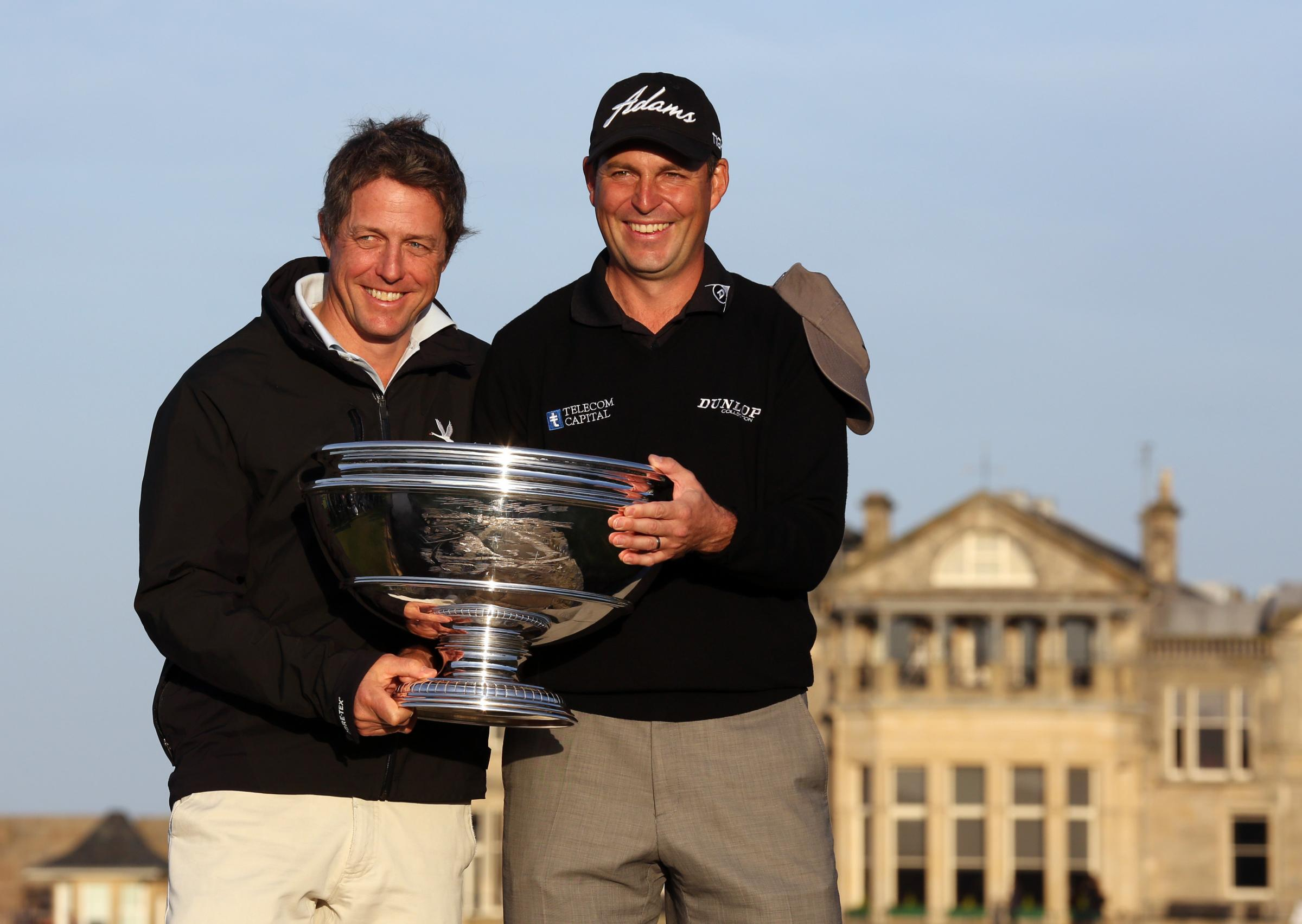 David Howell with partner Hugh Grant (left) celebrate winning the 2013 Alfred Dunhill Links Championships at St Andrews