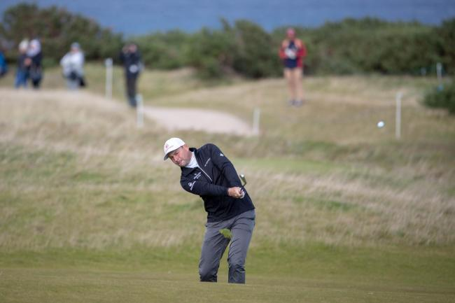 England's David Howell plays his approach shot into the 18th hole at Kingsbarns yesterday
