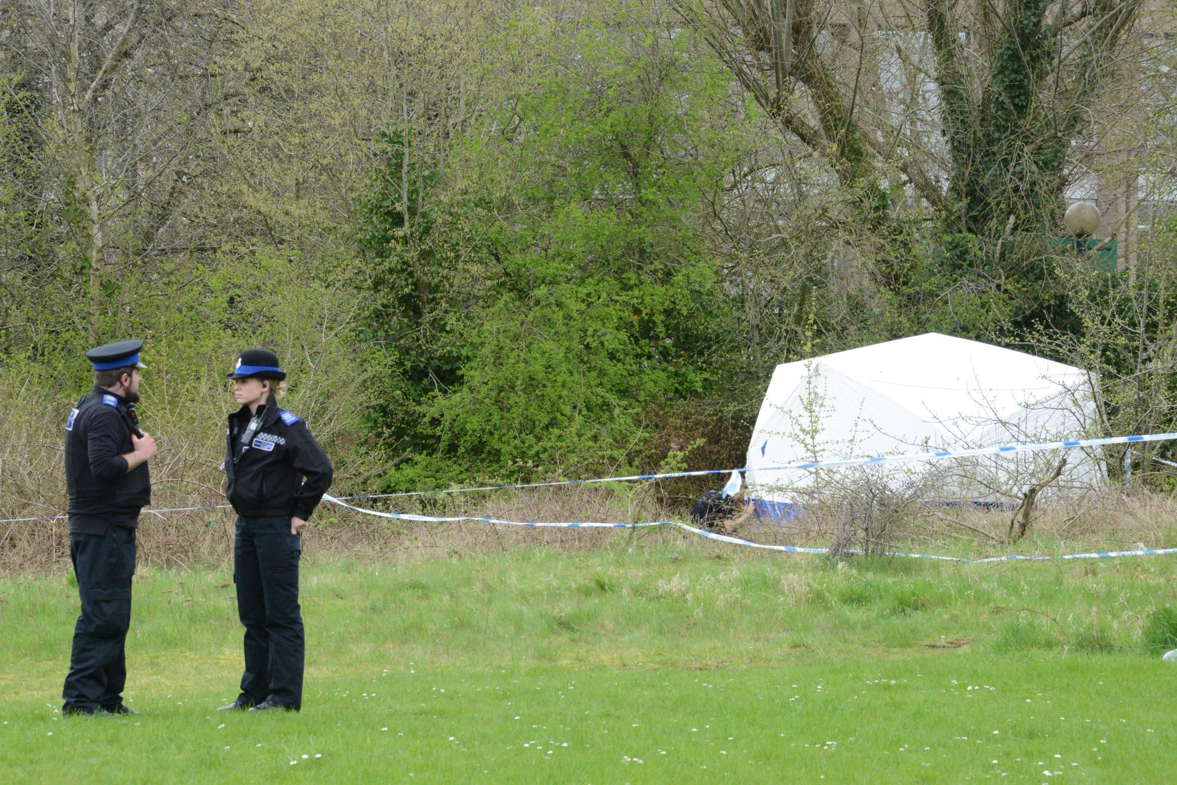 Police at the site of Mr Greenwood's death