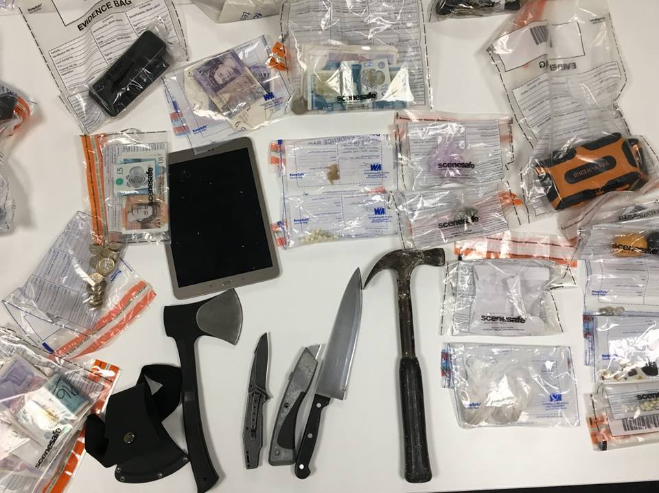 Weapons and other confiscated items seized by police on patrol in one night.