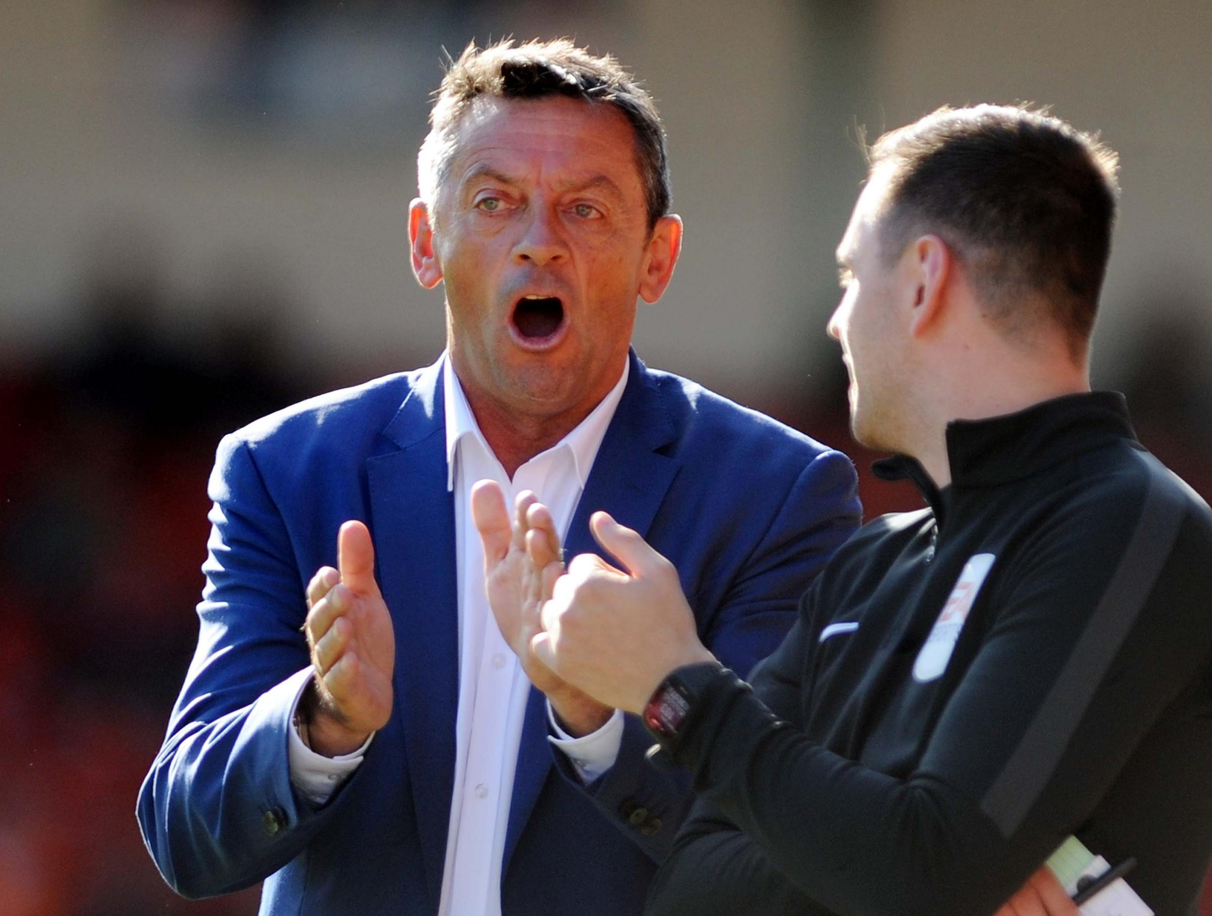 STFC v Oldham           Pic Dave Evans          29.09.18.Phil Brown swaps opinions with the fourth official..