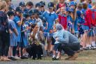 The Duke and Duchess of Sussex are greeted by schoolchildren as they arrive at Dubbo City Regional Airport