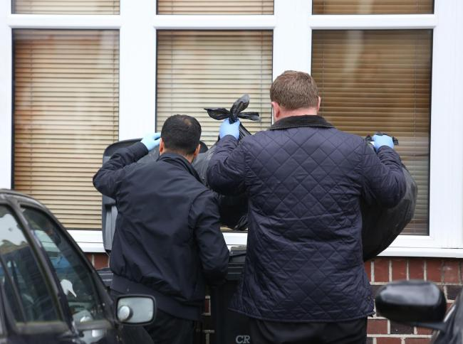 Police officers examine the contents of bins outside a house on Norhyrst Avenue in South Norwood, London, where it is believed a model of Grenfell Tower was burnt on a bonfire. Five men are being questioned by police after handing themselves in at a polic