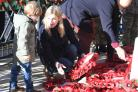 ©Calyx Picture Agency .Swindon Remembers with a service at the Regent Circus Cenotaph..Zachary and his mother lay a wreath in memory of S/Sgt Vincent Phillips SAS.