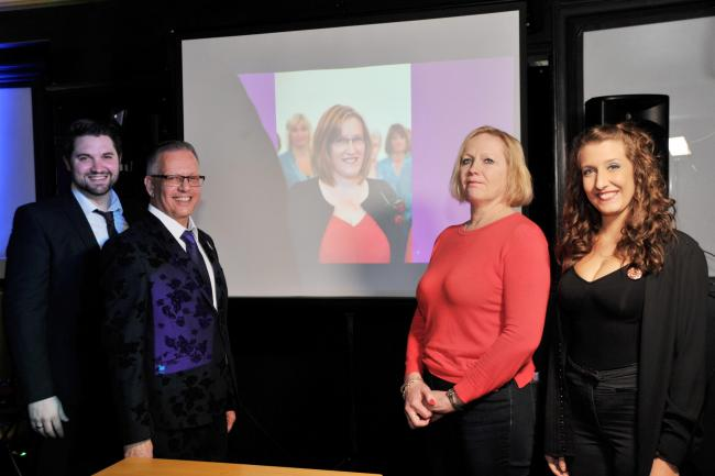 Songwriters Andy Merryweather and Clarry Bean together with a picture of Christine and charity representatives Jayne Hardman and Abby Mansi. Picture: DAVE COX