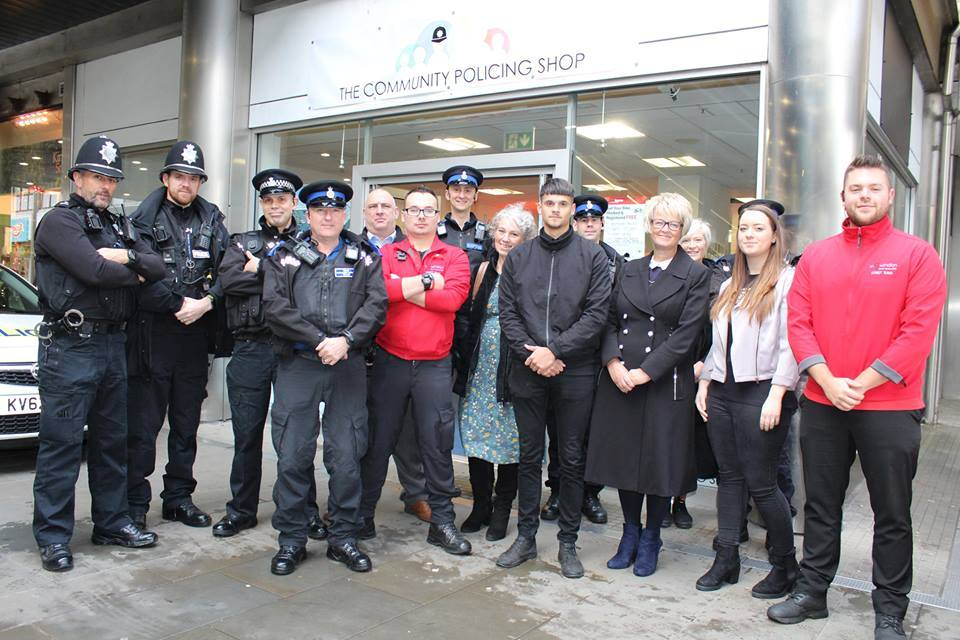 Wiltshire Police and inSwindon teams outside the community shop in the town centre.
