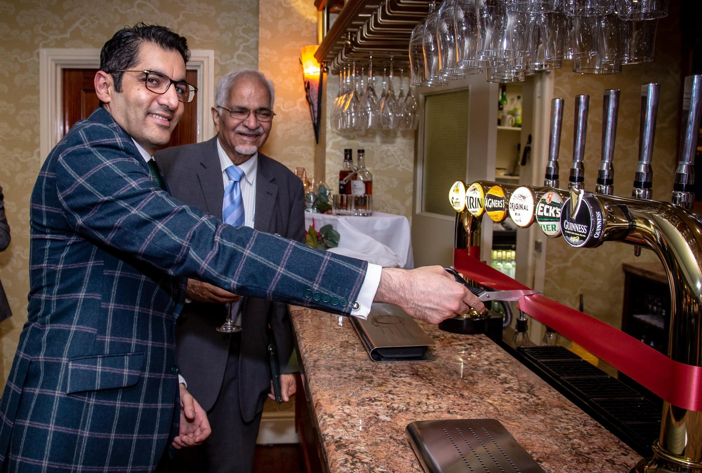 Dr Aman Puri and prof Nat Puri CBE cut the ribbon to officially open the new bar and restaurant in the Cricklade Hotel