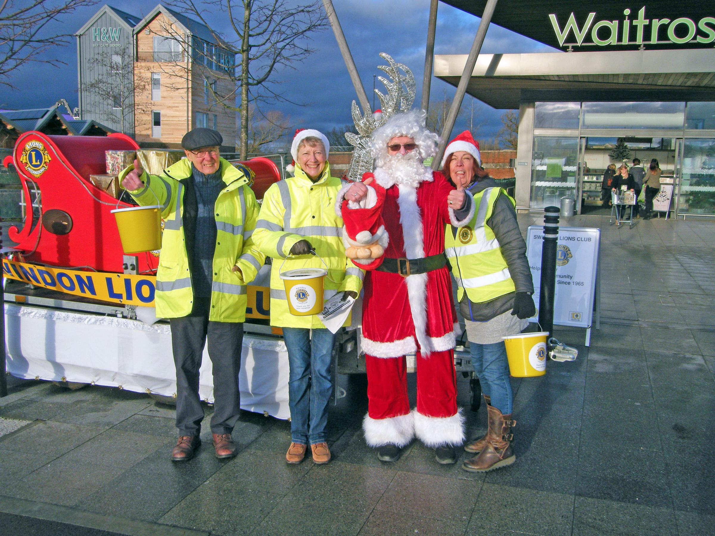 Alan Mitchell with other Swindon Lions members collecting money for the appeal