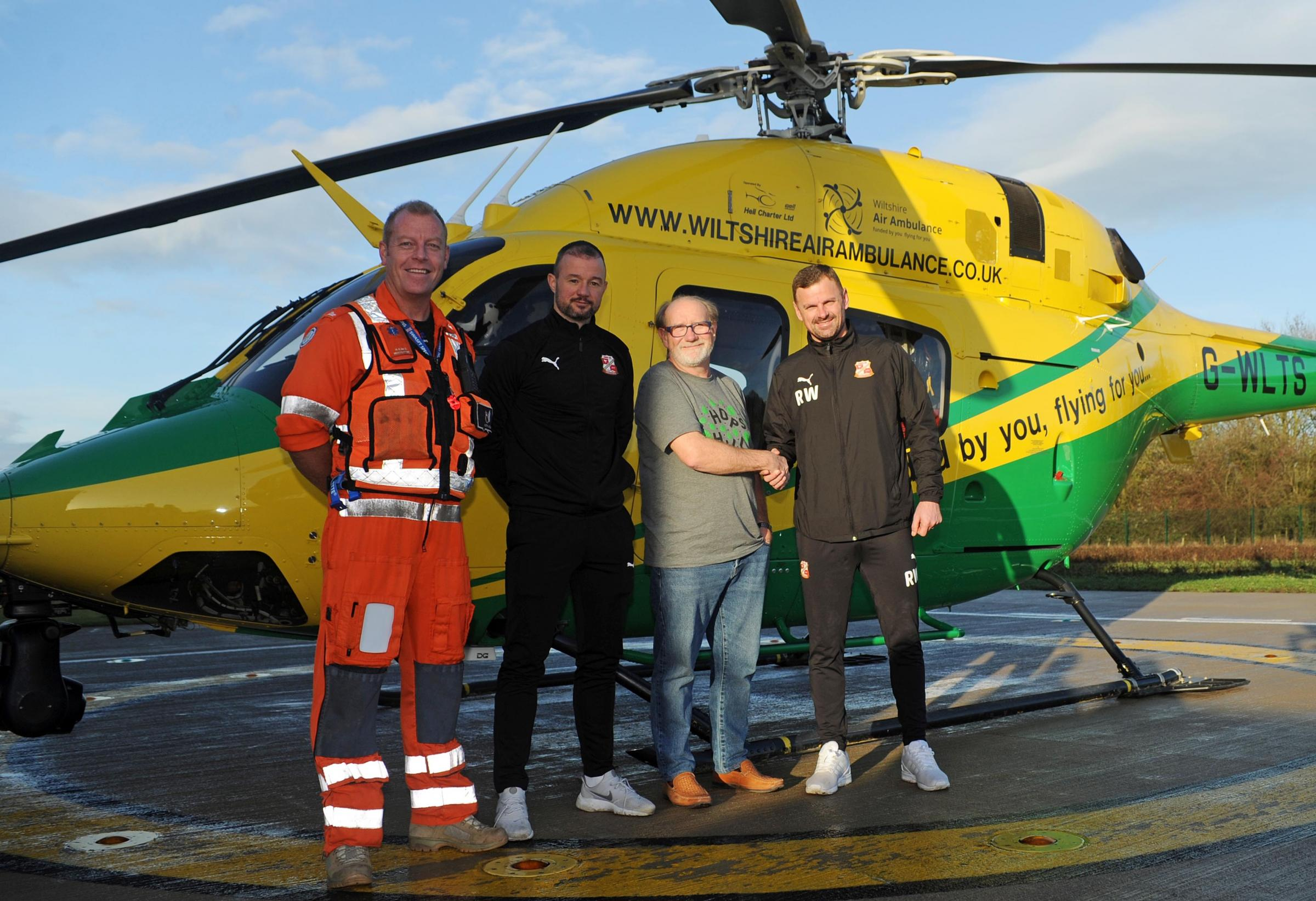 From left, Keith Mills, Wiltshire Air Ambulance paramedic, Noel Hunt, assistant manager of Swindon Town Football Club, David Philpott, Wiltshire Air Ambulance chief executive, and Richie Wellens, manager of Swindon Town Football Club, at the charity&rsquo
