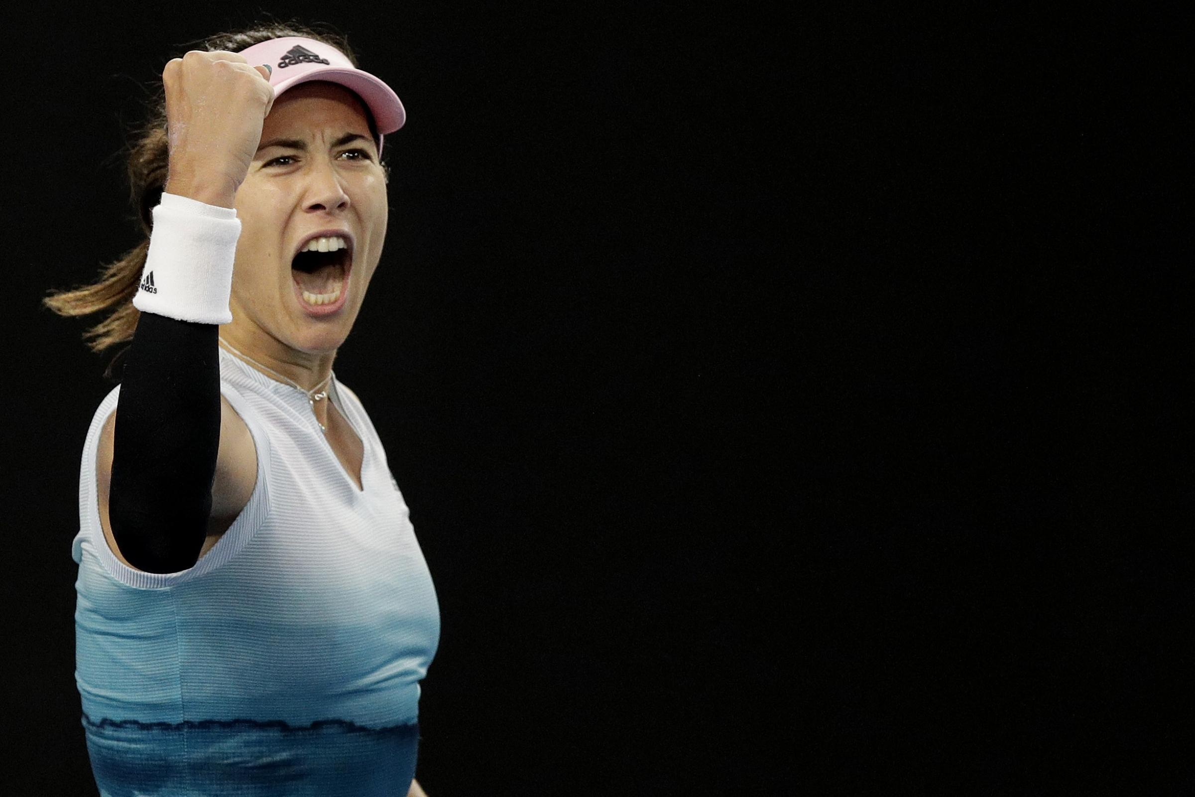 Garbine Muguruza celebrates her late-night triumph