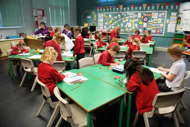 BUSY AT WORK:  A class at an infant school