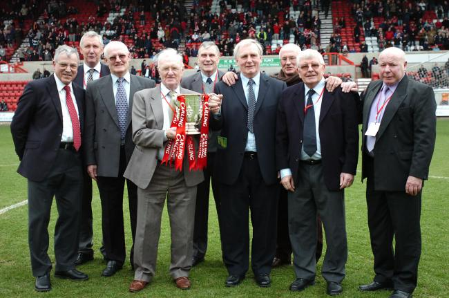 The late Danny Williams holding the League Cup with members of the 1969 team including Don Rogers, Rod Thomas, John Trollope, Roger Smart, Peter Downsborough, Don Heath, Joe Butler and Willie Penman.         PICTURE: Dave Evans
