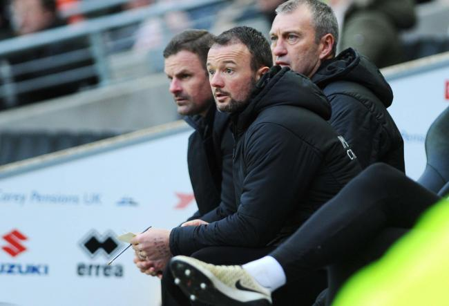 Swindon Town manager Richie Wellens (left), assistant Noel Hunt and first-team coach Peter Shirtliff (right) have come up with a six-week pre-season training programme for their squad            Picture: DAVE EVANS