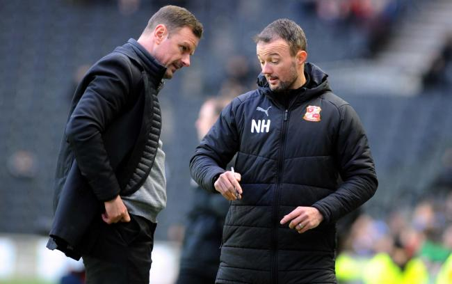 MK Dons v STFC           Pic Dave Evans         9.2.19.Richie Wellens and Noel Hunt discuss tactics on the touchline..