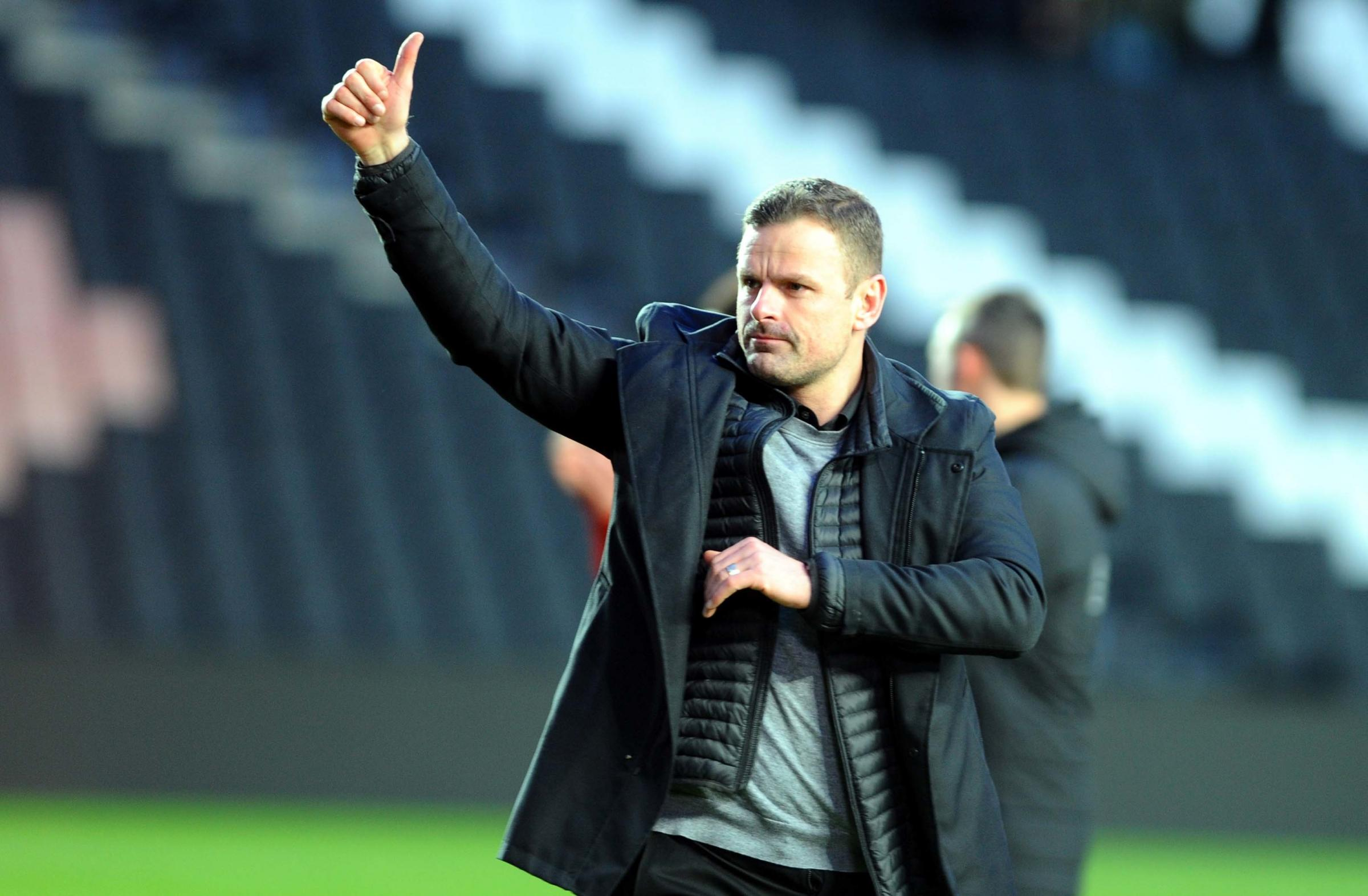 MK Dons v STFC           Pic Dave Evans         9.2.19.Town boss Richie Wellens salutes the travelling band of fans..