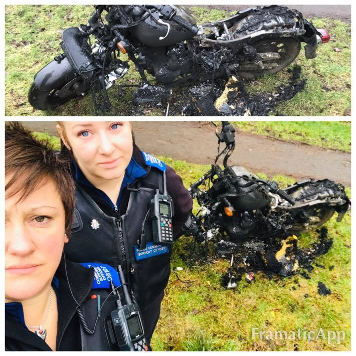 PCSOs with the burnt-out motorcycle in Swindon. Picture: SWINDON NORTH POLICE/FACEBOOK
