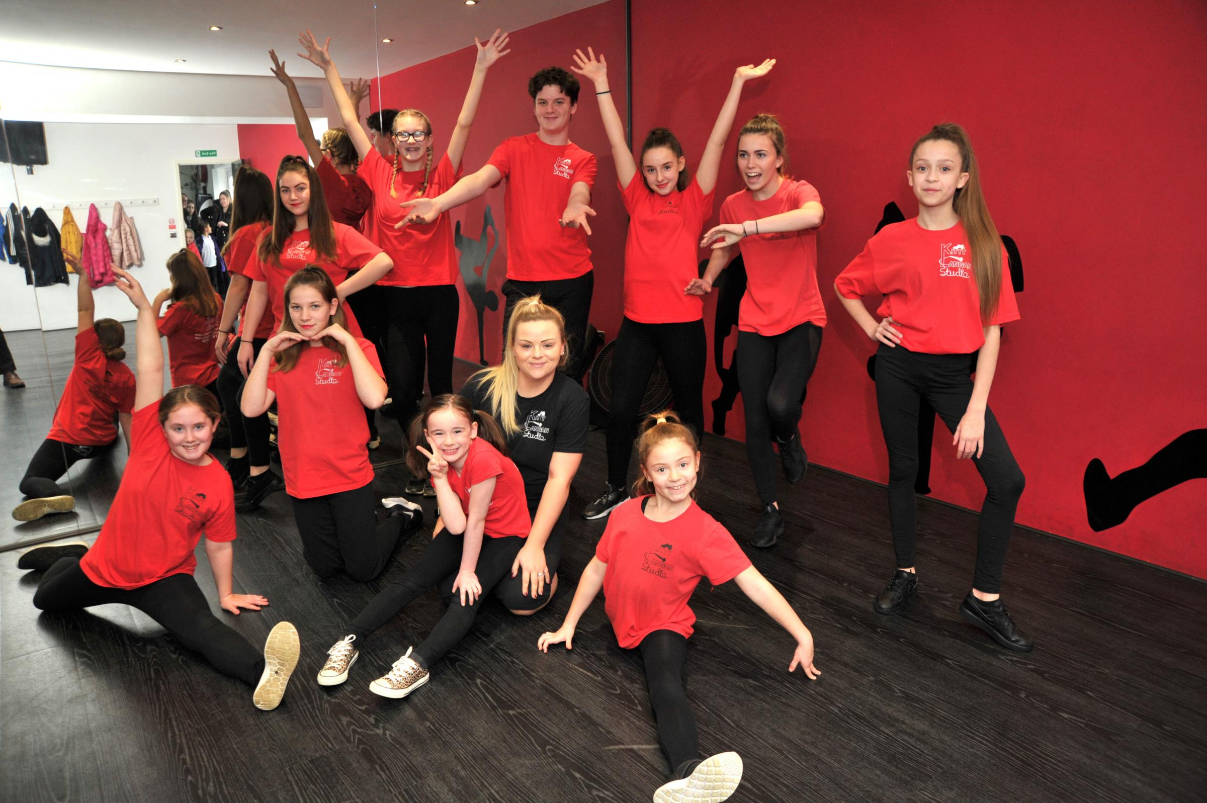 Children from Kitty Langan studio dance school will be performing in the Disneyland Paris parade in May this year.  Pic - Katie Kirby - centre with dance group Date 11/2/19 Pic by Dave Cox