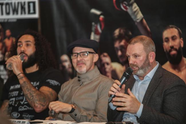 Promoter Mark Neilson speaks at the launch of the Fight Town 1 show on Saturday, as trainer Paddy Fitzpatrick and fighter Luke Watkins look on